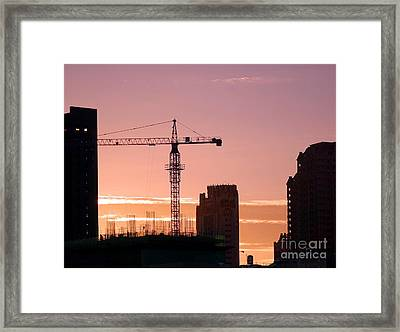 Busy City Construction Site At Sunset Framed Print