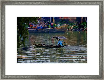 By The Flower Boat Framed Print