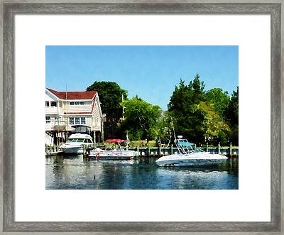 Framed Print featuring the photograph Cabin Cruisers by Susan Savad