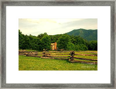 Cabin In The Meadow Framed Print