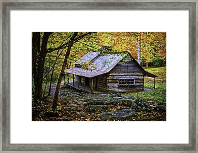 Cabin In The Woods Framed Print by Lawrence Golla