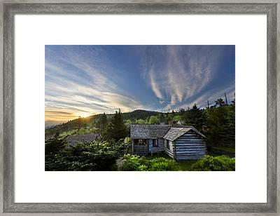 Cabins At Dawn Framed Print by Debra and Dave Vanderlaan