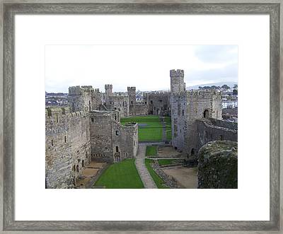 Framed Print featuring the photograph Caernarfon Castle by Christopher Rowlands