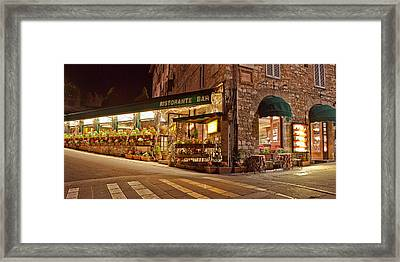 Cafe In Assisi At Night Framed Print by Susan Schmitz