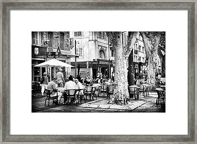 Cafe Time In Marseille Framed Print by John Rizzuto