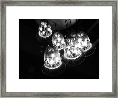 Caged Lights Framed Print by Justin Woodhouse