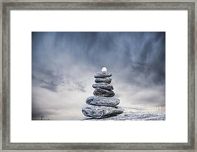 Cairn And Stormy Sky Framed Print by Colin and Linda McKie