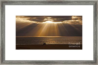 Calm Clouds With Magnificent Sun Rays Over Ocean Framed Print