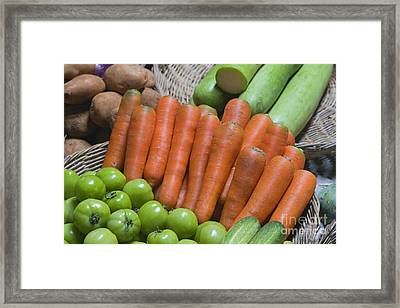 Cambodian Carrots Framed Print by Craig Lovell