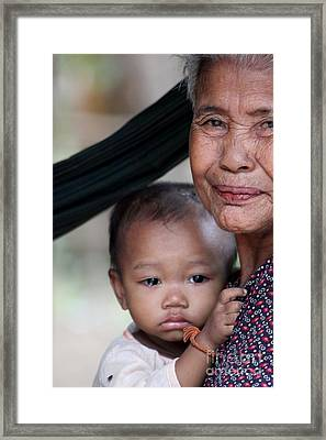 Framed Print featuring the photograph Cambodian Grandmother And Baby #3 by Nola Lee Kelsey