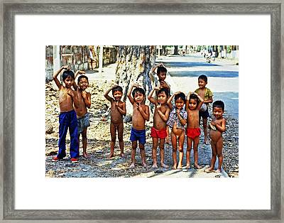 Cambodian Kids Framed Print by Joe  Connors