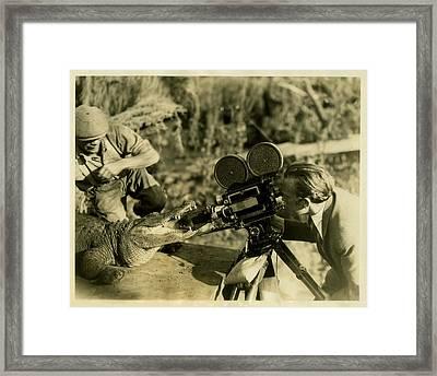 Cameraman With Alligator Framed Print by Vintage
