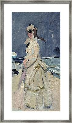 Camille On The Beach Framed Print by Claude Monet
