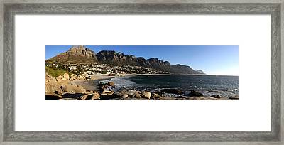 Camps Bay With The Twelve Apostles Framed Print by Panoramic Images