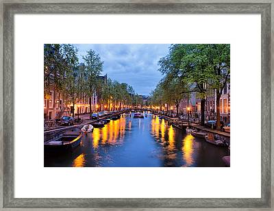 Canal In Amsterdam At Dusk Framed Print