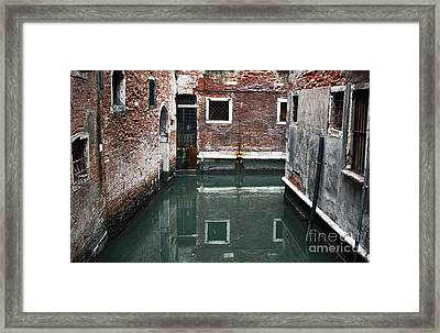 Canal Reflections Framed Print by John Rizzuto