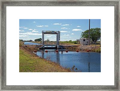 Canal Sluice Gate Framed Print by Jim West