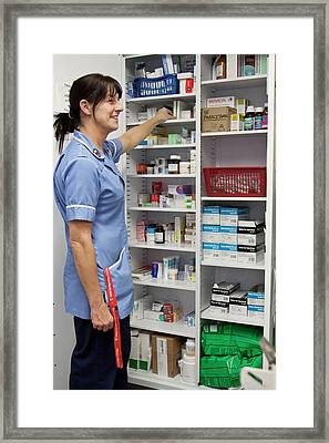Cancer Nurse Retrieving Drugs Framed Print by Life In View