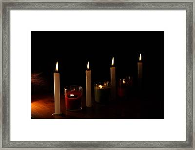 By The Flickering Light Framed Print