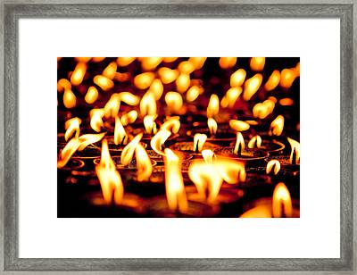 candle light in Boudnath stupa Framed Print by Raimond Klavins
