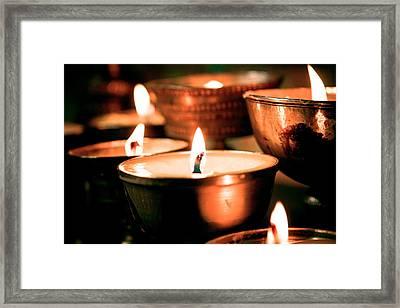 candle light ZUTHRUL PHUG MONASTERY Milarepas Cave Framed Print by Raimond Klavins