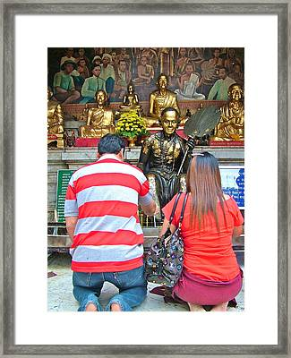 Candle Lighters At Wat Phrathat Doi Sutep In Chiang Mai-thailand Framed Print