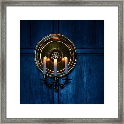 Candles And Blue Wooden Background Framed Print