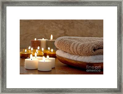 Candles And Towels In A Spa Framed Print by Olivier Le Queinec