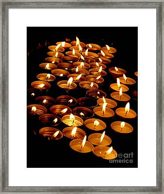 Candles In A Church As A Symbol Of A Prayer Framed Print by Federico Candoni