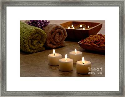 Candles In A Spa Framed Print by Olivier Le Queinec
