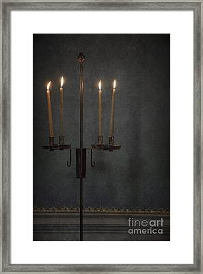 Candles In The Dark Framed Print