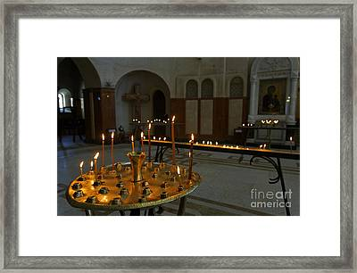 Candles Inside The Tsminda Sameba Cathedral Tbilisi Framed Print by Robert Preston