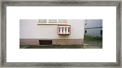 Candy Vending Machine On The Wall Framed Print by Panoramic Images