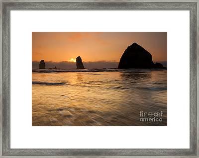 Cannon Beach Tides Framed Print by Mike Dawson