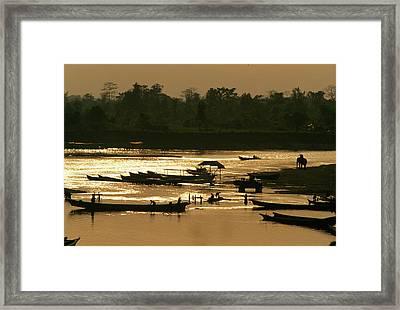 Canoe Activity At Twilight On The Tanai Framed Print by Steve Winter