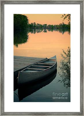 Canoe At A Dock At Sunset Framed Print by Jill Battaglia