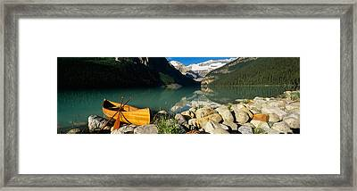 Canoe At The Lakeside, Lake Louise Framed Print by Panoramic Images