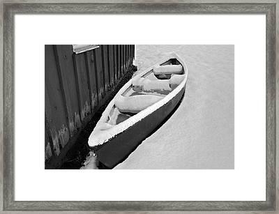 Canoe In The Snow Framed Print by Susan Leggett