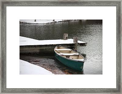 Canoe In Winter Framed Print