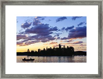 Canoeing At Sunset Framed Print