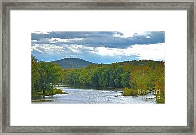 Canoeing The River Framed Print