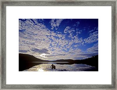 Canoeist And Cloudy Sky, Bowron Lake Framed Print by Chris Harris