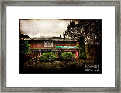 Canoes For Rent Framed Print by Dan Friend