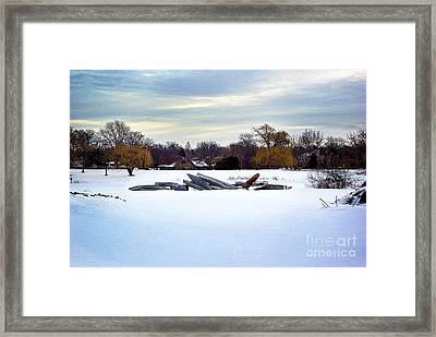 Canoes In The Snow Framed Print