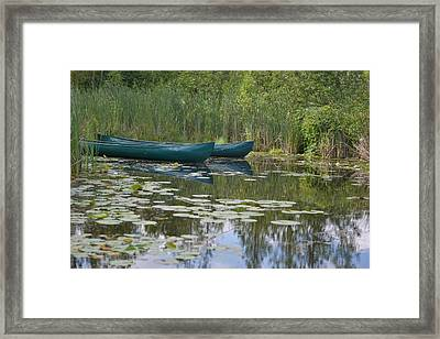 Canoes On Marshland Framed Print