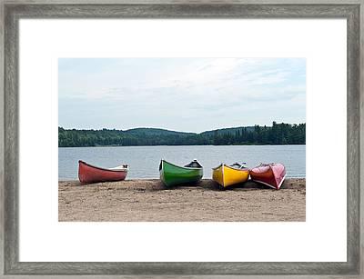 Canoes On The Lake Framed Print by Marek Poplawski
