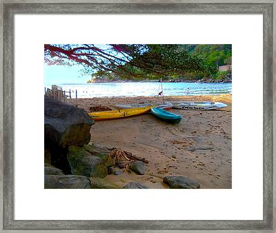 Canoes Wait At A Pacific Sunset Framed Print
