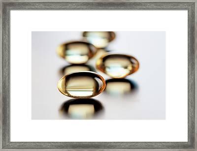 Capsules Framed Print by Wladimir Bulgar