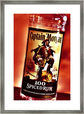Captain Morgan Red Toned Framed Print by Janie Johnson