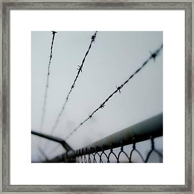 Captive Framed Print by Aaron Aldrich